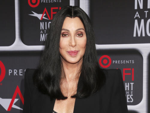 "FILE - This April 24, 2013 file photo shows performer Cher at the AFI Night at the Movies at the ArcLight in Los Angeles. Cher will be performing on the singing competition series ""The Voice"" during the season finale on Tuesday, June 18. She will perform ""Woman's World"" the first single off of her upcoming album. (Photo by Todd Williamson/Invision/AP, file)"