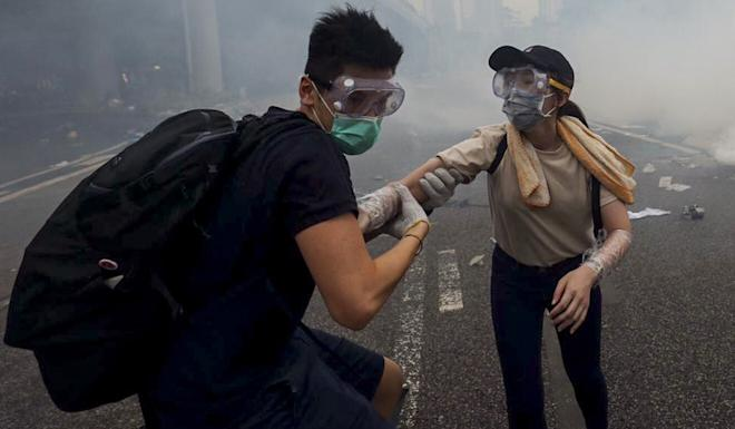 After police fired 150 rounds of tear gas at protesters on June 12, the target of anger widened to include not just the government, but also the officers who were accused of using excessive force. Photo: Sam Tsang