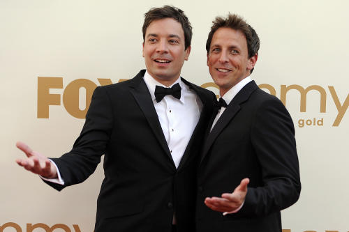 "FILE This Sept. 18, 2011 file photo shows Jimmy Fallon, left, and Seth Meyers at the 63rd Primetime Emmy Awards in Los Angeles. Meyers is moving from his ""Weekend Update"" desk to his own late night show on NBC. The network said Sunday, May 12, 2013 that the longtime ""Saturday Night Live"" cast member will replace Jimmy Fallon at the 12:35 a.m. ""Late Night"" show. Fallon will be moving up an hour as Jay Leno's replacement on the ""Tonight"" show. (AP Photo/Chris Pizzello, file)"