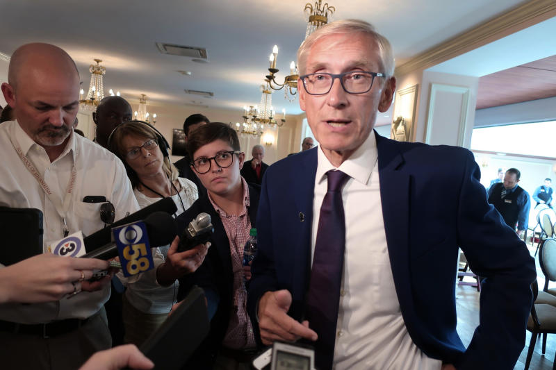 FILE - In this Sept. 24, 2019, file photo, Wisconsin Gov. Tony Evers speaks with reporters at an event in Madison, Wis. Wisconsin's Republican-controlled state Senate is preparing to take the extraordinary step of removing the state's agriculture secretary who was appointed by the Democratic governor. It is the latest flash point in a series of ongoing tensions that began even before the governor took office in January. (AP Photo/Scott Bauer File)