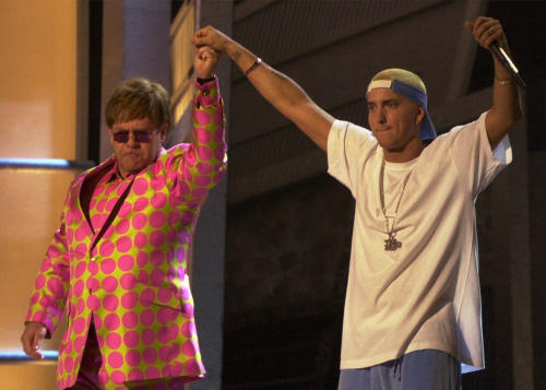 FILE - In this Feb. 21, 2001 file photo, Elton John, left, and Eminem appear together after performing a duet near the end of the 43rd annual Grammy Awards, at the Staples Center in Los Angeles. Anti-gay sentiments have been entrenched in hip-hop for decades. Eminem, widely known for offensive lyrics toward homosexuals, has joined Jay-Z in saying people of the same-sex should be able to love one another. (AP Photo/Kevork Djansezian, File)