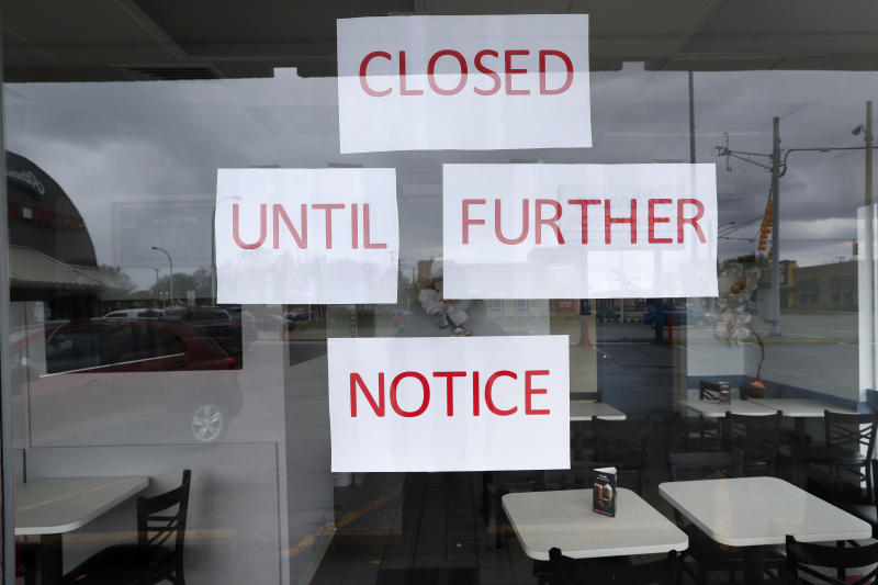 Vasi's Cafe is shown closed in St. Clair Shores, Mich., Friday, May 8, 2020. Many restaurants have closed due to the coronavirus pandemic. (AP Photo/Paul Sancya)