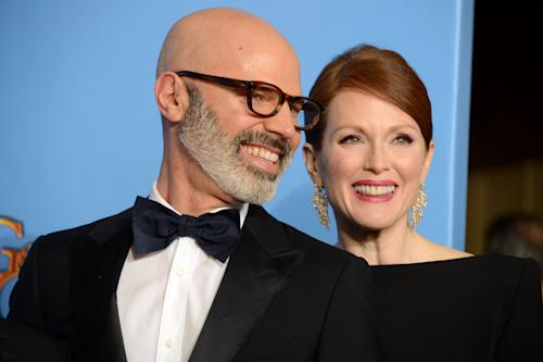 """Producer Steve Shareshian, left, and actress Julianne Moore pose with the award for best miniseries or motion picture made for television for """"Game Change"""" backstage at the 70th Annual Golden Globe Awards at the Beverly Hilton Hotel on Sunday Jan. 13, 2013, in Beverly Hills, Calif. (Photo by Jordan Strauss/Invision/AP)"""