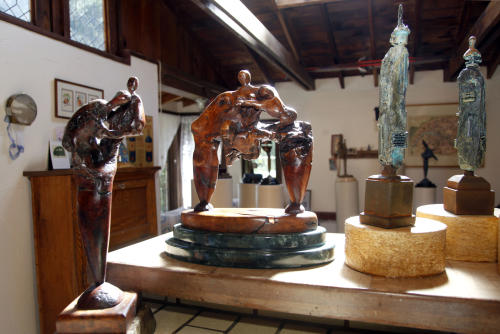 "In this Thursday, Sept. 18, 2012 photo, works by Tony Dow, actor, director and artist, from left, Two Figures and Struggle, are seen at his home and studio in the Topanga area of Los Angeles. When it comes time to sitting down in a studio and carving out bronze and wooden sculptures inspired by the nature all around him, Wally isn't leaving it up to the Beav these days. Dow, who famously played the Beaver's older brother Wally on the classic 1950s-60s sitcom ""Leave it To Beaver,"" is carving out a name for himself in the art world these days, as an abstract artist. (AP Photo/Reed Saxon)"