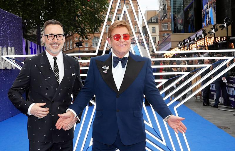 Musician Elton John and producer David Furnish, left, arrive for the UK Film Premiere of Rocketman at the Odeon Luxe in London, Monday, May 20, 2019.(AP Photo/Frank Augstein)