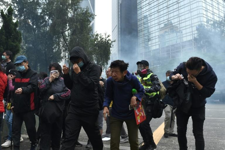 Riot police swept into the area and fired tear gas to disperse the crowds