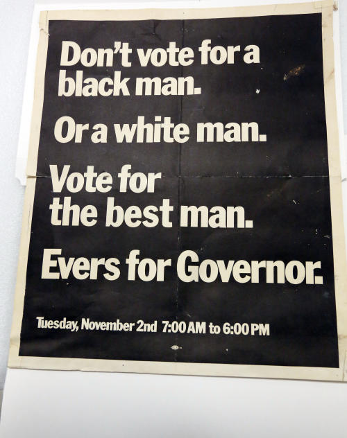 In this Oct. 11, 2013 photograph, items like this poster used by former Fayette, Miss., Mayor Charles Evers, brother of slain civil rights leader Medgar Evers, during his campaign for governor, will eventually be displayed in the state civil rights museum in Jackson, Miss. Officials say they did not set out to have separate-but-equal museums for the documentation of the state's history, but it could end up that way. Mississippi breaks ground Thursday. Oct. 24, 2013, on side-by-side museums that are expected to break ground of their own in how they depict the Southern state once rocked by racial turmoil. (AP Photo/Rogelio V. Solis)