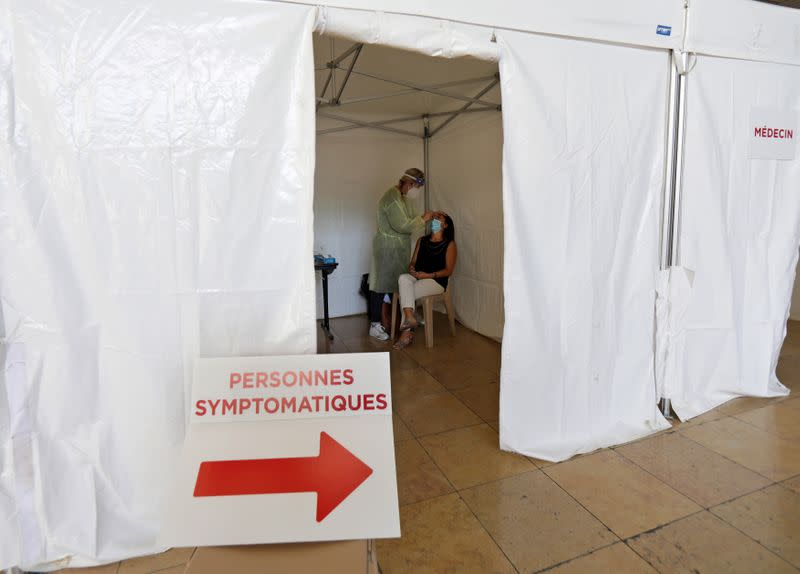 France's daily COVID-19 cases pass 10,000 for first time