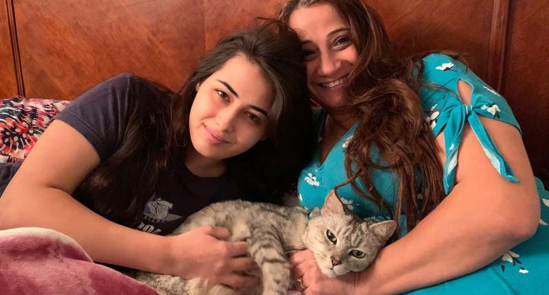 Cleo Kendirjian pictured with her mother Esther and cat Polar -- returned to them after three years. Source: Community Cat Carers Inc.