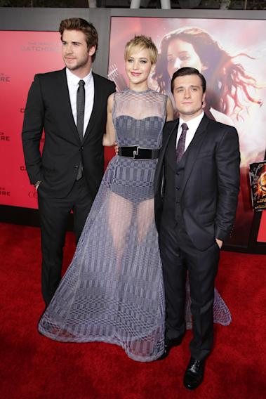 From left, Liam Hemsworth, Jennifer Lawrence and Josh Hutcherson seen at Lionsgate's 'The Hunger Games: Catching Fire' Los Angeles Premiere, on Monday, Nov, 18, 2013 in Los Angeles. (Photo by Eric Charbonneau/Invision for Lionsgate/AP Images)