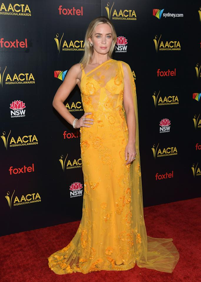 <p>Emily Blunt was a vision in yellow as she worked the red carpet. Photo: Getty </p>