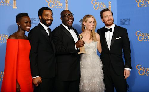 "From left, Lupita Nyong'o, Chiwetel Ejiofor, Steve McQueen, Sarah Paulson, and Michael Fassbender pose in the press room with the award for best motion picture - drama for ""12 Years a Slave"" at the 71st annual Golden Globe Awards at the Beverly Hilton Hotel on Sunday, Jan. 12, 2014, in Beverly Hills, Calif. (Photo by Jordan Strauss/Invision/AP)"
