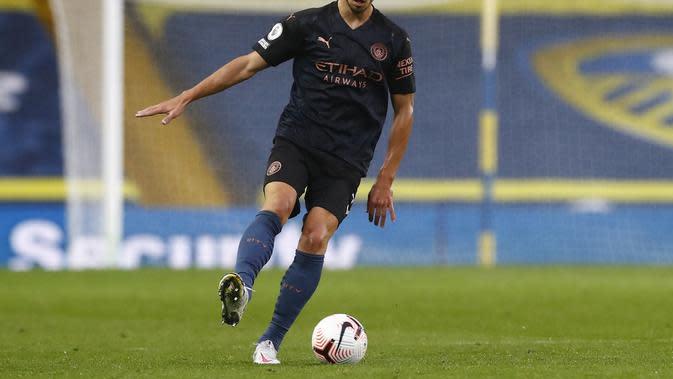Ruben Dias lakoni debut saat Manchester City bermain imbang 1-1 kontra Leeds United, Minggu (4/10/2020) dini hari WIB. (JASON CAIRNDUFF / POOL / AFP)