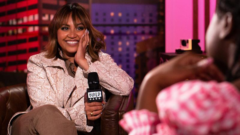 A photo of singer Jessica Mauboy on the set of Build Series Sydney with host Flex Mami.
