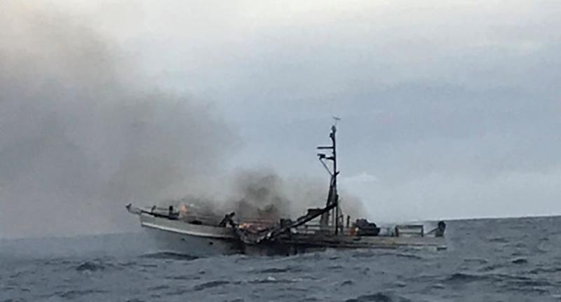 A boat on fire off the Queensland coast.
