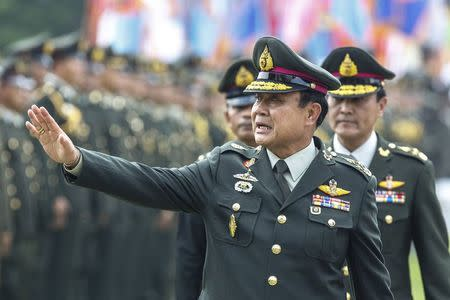 Thailand's Prime Minister Prayuth Chan-ocha waves after a handover ceremony for the new Royal Thai Army Chief at the Thai Army Headquarters in Bangkok