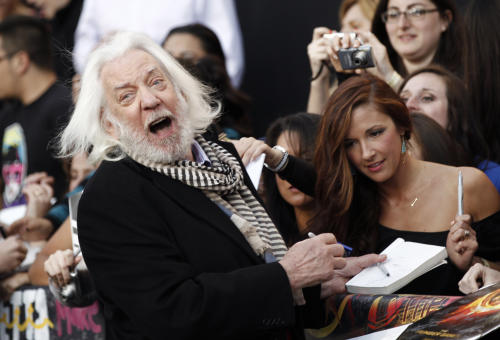 "Donald Sutherland arrives at the world premiere of ""The Hunger Games"" on Monday March 12, 2012 in Los Angeles. (AP Photo/Matt Sayles)"