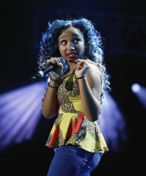 Breaunna Womack, known as Baby Doll of The OMG Girls, performs at the Essence Music Festival in New Orleans, Thursday, July 5, 2012. This is the first day of the four day music festival. (Photo by Bill Haber/Invision/AP)