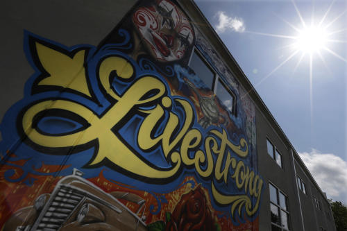 A mural is seen on the Lance Armstrong foundation building, Friday, Aug. 24, 2012, in Austin, Texas. The U.S. Anti-Doping Agency stripped Armstrong of his seven Tour de France titles Friday, erasing one of the most incredible achievements in sports after deciding he had used performance-enhancing drugs to do it. (AP Photo/Eric Gay)
