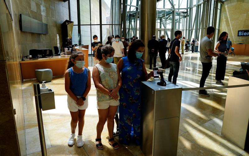 Visitors use an app to enter the Guggenheim Museum on the day it reopens its doors following a three-month closure - VINCENT WEST/REUTERS
