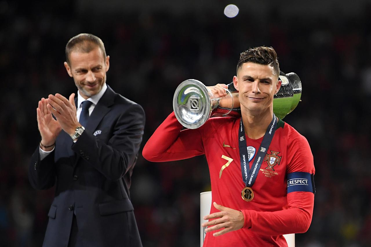 Cristiano Ronaldo of Portugal celebrates with the UEFA Nations League Trophy following his team's victory in the UEFA Nations League Final between Portugal and the Netherlands at Estadio do Dragao on June 09, 2019 in Porto, Portugal. (Photo by Lukas Schulze - UEFA/UEFA via Getty Images)