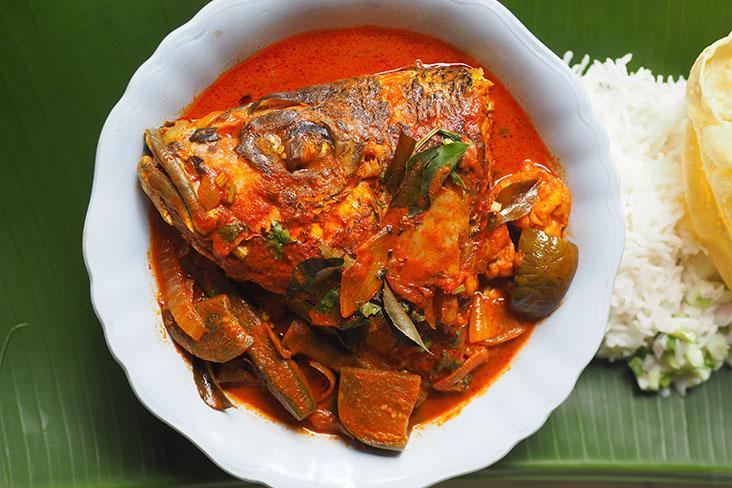 Indulge in this fish head curry served with jenahak fish, beancurd puffs, lady's fingers, tomatoes and eggplants. — Pictures by Lee Khang Yi