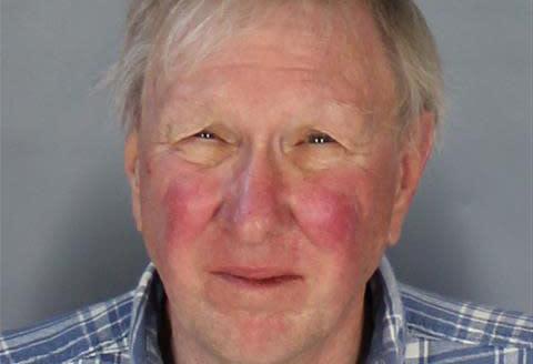 Gomoll is seen in a police mugshot