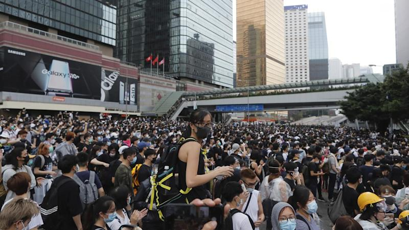 Tens of thousands of protesters have stormed key roads near Hong Kong's Legislative Council