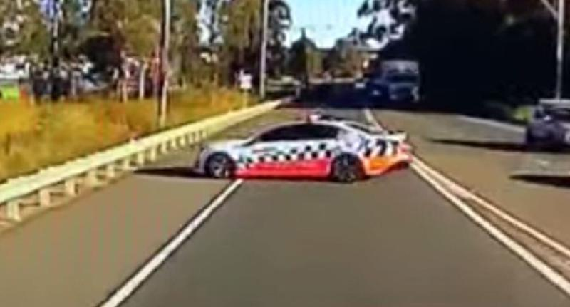 Truck driver Jason Kemp's dash cam video shows the NSW Police car making the U-turn in NSW's Lower Hunter Valley.