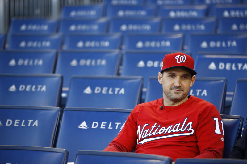 FILE - In this Oct. 18, 2019, file photo, Washington Nationals first baseman Ryan Zimmerman sits in the stands as he participates in a television interview after a baseball workout in Washington. Zimmerman is offering his thoughts as told to AP in a diary of sorts while waiting for the 2020 season to begin. (AP Photo/Patrick Semansky, File)