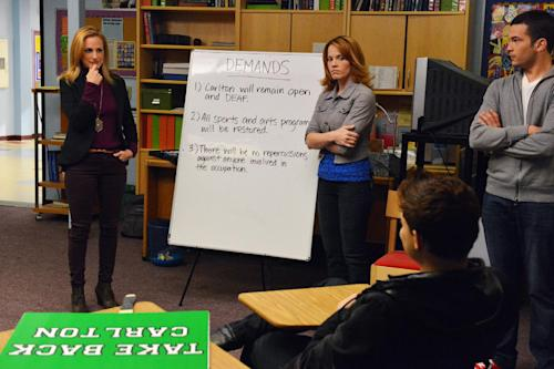 """This publicity image released by ABC Family shows from left, Marlee Matlin, Katie Leclerc and Brian Gutierrez in a scene from ABC Family's TV series, """"Switched at Birth."""" When news of the school's closing spreads, the students of Carlton School for the Deaf stage a protest. (AP Photo/ABC Family/Eric McCandless)"""