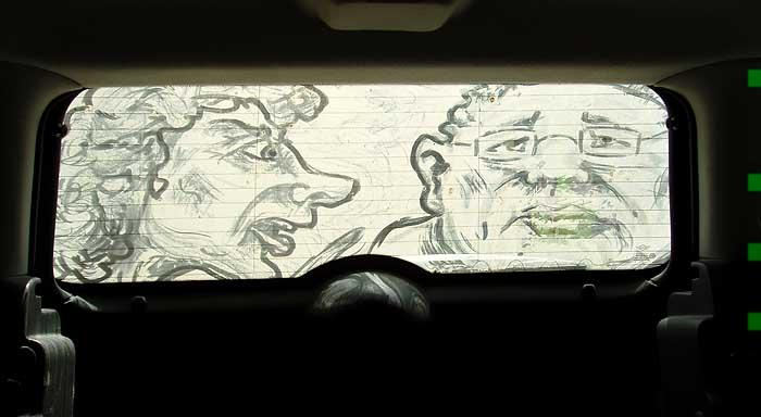 The Nag: Detail | From inside the car. With a light background, the image looks like a negative.