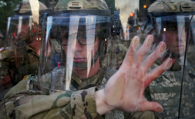 Soldier holds his position during a protest in Washington