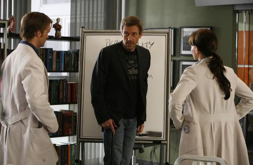 "In this image released by Fox, Hugh Laurie, center, portrays Dr. Gregory House in a scene from ""House, M.D."" The Fox medical drama concludes its eight-season run on Monday, May 21, 2012, with a finale at 9 p.m. EDT, preceded by a one-hour retrospective. (AP Photo/Fox, Isabella Vosmikova)"