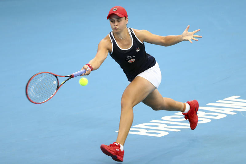 FILE - In this Jan. 9, 2020, file photo, Ashleigh Barty, of Australia, plays a shot during her match against Jennifer Brady, of the United States, at the Brisbane International tennis tournament in Brisbane, Australia. Barty will be competing in the Australian Open tennis tournament, beginning Monday, Jan. 20, 2020. (AP Photo/Tertius Pickard, File)
