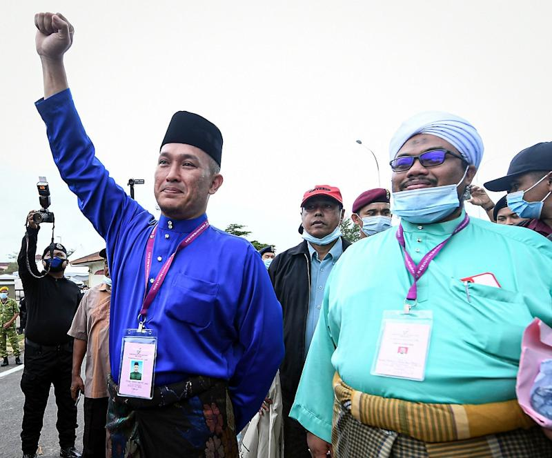 Barisan Nasional candidate Mohd Sharim Md Zain (left) arrives at the nomination centre in Pekan June 20, 2020. ― Bernama pic