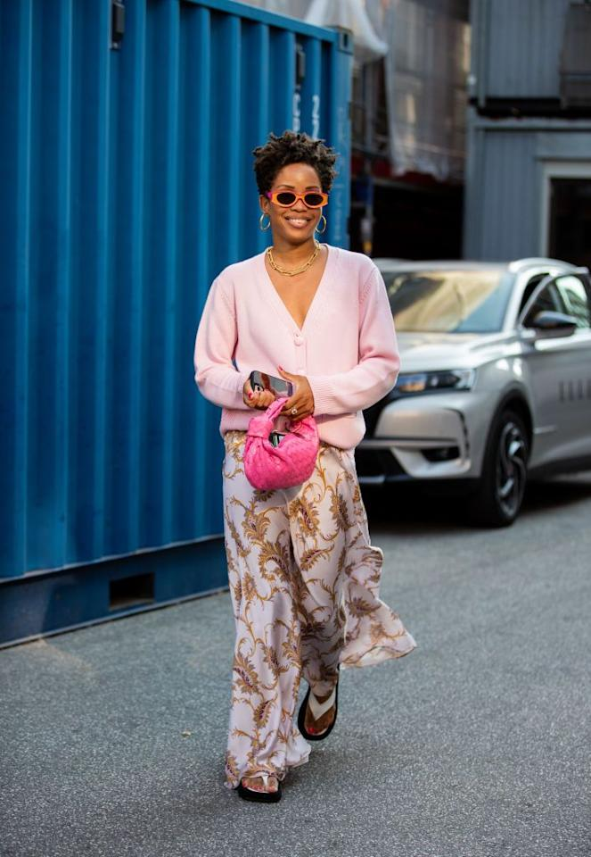 <p>One foolproof way to create a cozy outfit is by pairing a slouchy jumper with more polished pieces. Try styling it with a printed slip skirt when transitioning through the seasons.</p>