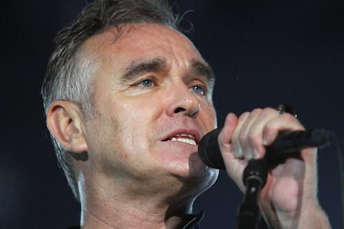 FILE - In this July 21, 2012 file photo, British rock singer Morrissey, the former front man of the alternative rock group The Smiths, sings during his concert in Tel Aviv, Israel. Health concerns are forcing Morrissey to cancel his North American tour. In a statement released Friday night, his rep says the singer has to take a break after suffering a series of maladies, including double pneumonia, a bleeding ulcer and a gastrointestinal problem called Barrett's esophogas. (AP Photo/Dan Balilty, File)