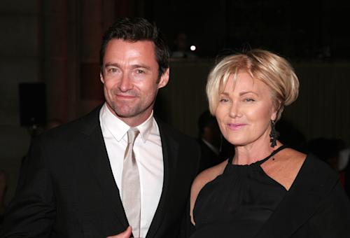 FILE - Actor Hugh Jackman, left, and his wife, actress Deborra-Lee Furness, right, attend the New Yorkers For Children Fall Gala 2013 in this, Sept. 17, 2013 file photo taken in New York. Jackman revealed early Friday Nov. 22, 2013 the has been treated for skin cancer and shared a selfie showing his bandaged nose. (Photo by Andy Kropa/Invision/AP)
