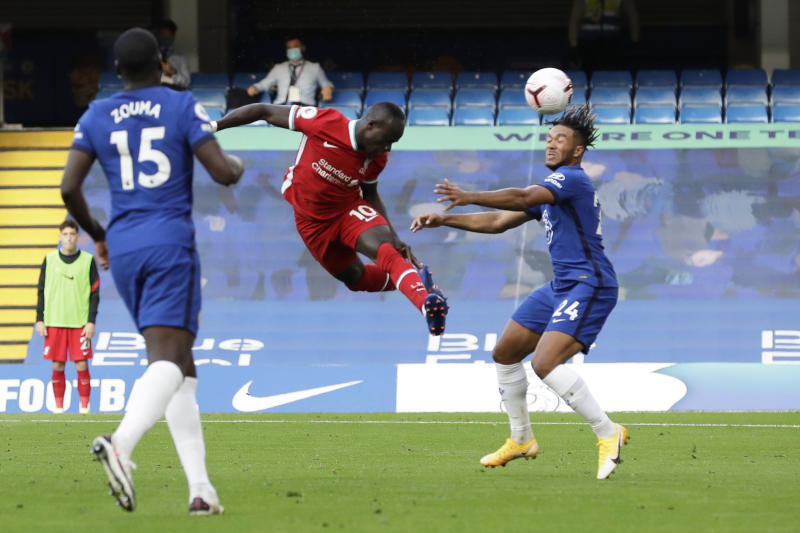 Soccer Football - Premier League - Chelsea v Liverpool - Stamford Bridge, London, Britain - September 20, 2020 Liverpool's Sadio Mane scores their first goal Pool via REUTERS/Matt Dunham EDITORIAL USE ONLY. No use with unauthorized audio, video, data, fixture lists, club/league logos or 'live' services. Online in-match use limited to 75 images, no video emulation. No use in betting, games or single club/league/player publications. Please contact your account representative for further details.
