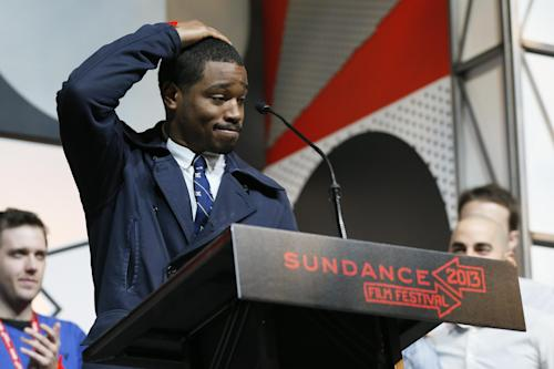"FILE - In this Jan. 26, 2013 file photo director-screenwriter Ryan Coogler accepts the U.S. Grand Jury Prize: Dramatic for his film, ""Fruitvale"" during the 2013 Sundance Film Festival Awards Ceremony in Park City, Utah. Coogler's ""Fruitvale Station"" _ his first dramatic feature and first project since graduating with a master's degree in 2011 _ won both jury and audience awards at the Sundance Film Festival. Originally called ""Fruitvale,"" the film opens Friday, July 12, in New York and Los Angeles and around the nation later this month, and Oscar buzz has already begun. (Photo by Danny Moloshok/Invision/AP, file)"
