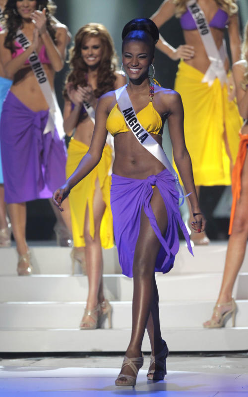 Miss Angola Leila Lopes steps forward after she was named a finalist at the Miss Universe pageant in Sao Paulo, Brazil, Monday, Sept. 12, 2011. Lopes was crowned Miss Universe 2011. (AP Photo/Andre Penner)