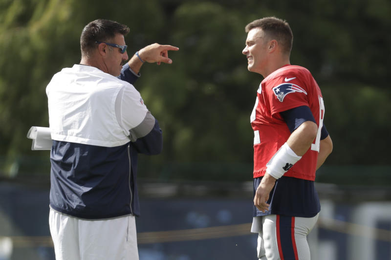 Tennessee Titans head coach Mike Vrabel talks with former New England Patriots teammate Tom Brady during a joint practice on Wednesday. (AP)