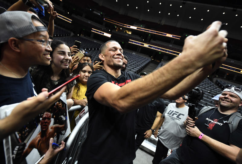 ANAHEIM, CA - AUGUST 14: Former UFC lightweight title challenger Nate Diaz takes a selfie with fans after holding an open workout for fans and media at Honda Center on August 14, 2019 in Anaheim, California. (Photo by Kevork Djansezian/Zuffa LLC/Zuffa LLC)