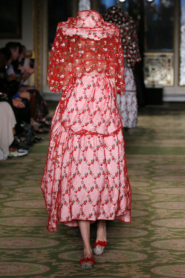 <p>Simone Rocha always proves a hot ticket come Fashion Week and this season, the designer stepped the gothic drama up a notch. Inspired by the Tang dynasty, models stepped out in dramatic petticoats with ladylike handbags on the crook of their arm. But it was the dramatic sheer veils which really stole the spotlight. Photo: Getty </p>