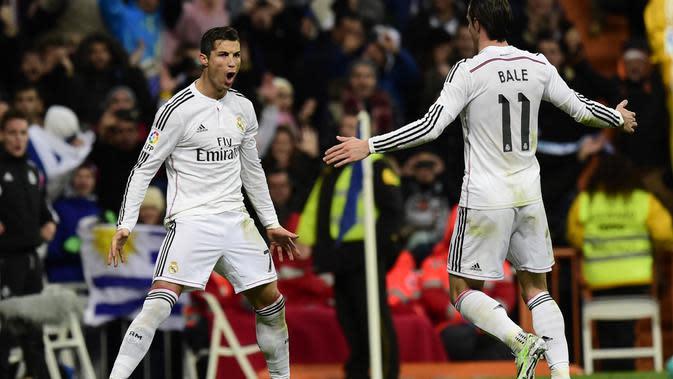 Gaya selebrasi Cristiano Ronaldo setelah mencetak gol untuk Real Madrid, 6 Desember 2014. Gaya ini menjadi ciri khas CR7. (AFP/Javier Soriano)