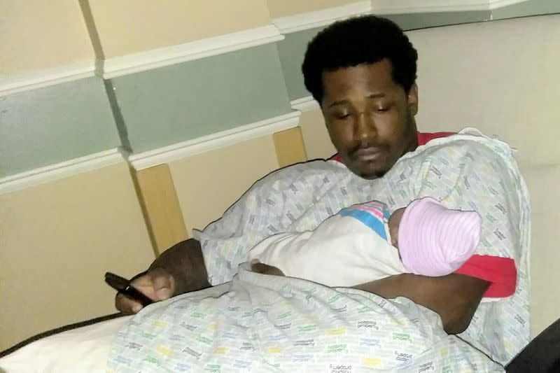 Rayshard Brooks, who was shot to death by former Atlanta Police Department officer Garrett Rolfe, holds his daughter in an undated photograph