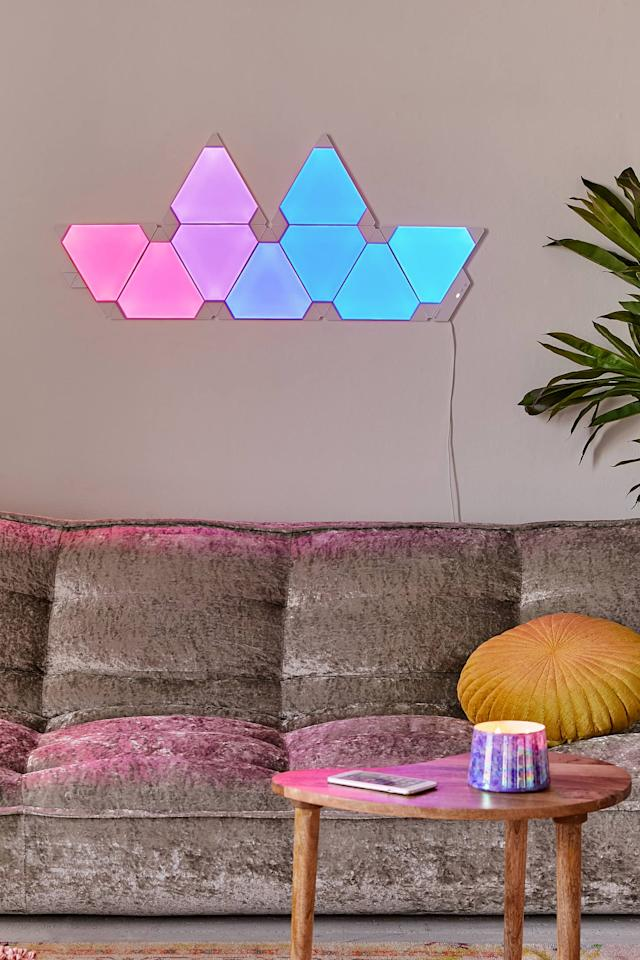 """<p>You can sync this <a href=""""https://www.popsugar.com/buy/Nanoleaf-Rhythm-Modular-Lighting-System-Kit-563822?p_name=Nanoleaf%20Rhythm%20Modular%20Lighting%20System%20Kit&retailer=urbanoutfitters.com&pid=563822&price=230&evar1=casa%3Aus&evar9=45637069&evar98=https%3A%2F%2Fwww.popsugar.com%2Fhome%2Fphoto-gallery%2F45637069%2Fimage%2F47375060%2FNanoleaf-Rhythm-Modular-Lighting-System-Kit&list1=shopping%2Cgadgets%2Ctech%20shopping%2Chome%20shopping&prop13=api&pdata=1"""" rel=""""nofollow"""" data-shoppable-link=""""1"""" target=""""_blank"""" class=""""ga-track"""" data-ga-category=""""Related"""" data-ga-label=""""https://www.urbanoutfitters.com/shop/nanoleaf-rhythm-modular-lighting-system-kit?category=smart-home-tech&amp;color=095&amp;type=REGULAR"""" data-ga-action=""""In-Line Links"""">Nanoleaf Rhythm Modular Lighting System Kit</a> ($230) to change colors along to your music.</p>"""