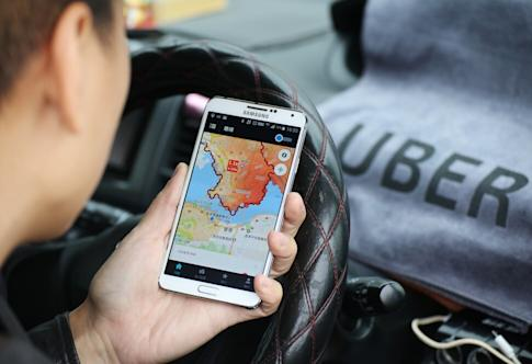 Uber has provided millions of trips since arriving in the city six years ago but its future here is shrouded in uncertainty because of licensing issues. Photo: Felix Wong