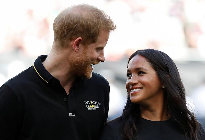 Britain's Prince Harry, Duke of Sussex and Britain's Meghan, Duchess of Sussex arrive on the field prior to the start of the first of a two-game series between the New York Yankees and the Boston Red Sox at London Stadium in Queen Elizabeth Olympic Park, east London on June 29, 2019. - As Major League Baseball prepares to make history in London, New York Yankees manager Aaron Boone and Boston Red Sox coach Alex Cora are united in their desire to make the ground-breaking trip memorable on and off the field. (Photo by PETER NICHOLLS / POOL / AFP) (Photo credit should read PETER NICHOLLS/AFP/Getty Images)